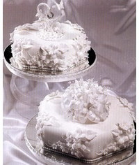 photo Wedding cake with flowers,bows and heart