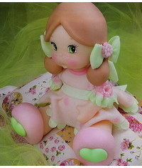 photo How to sculpt gumpaste (fondant, polymer clay) sitting girl figurine
