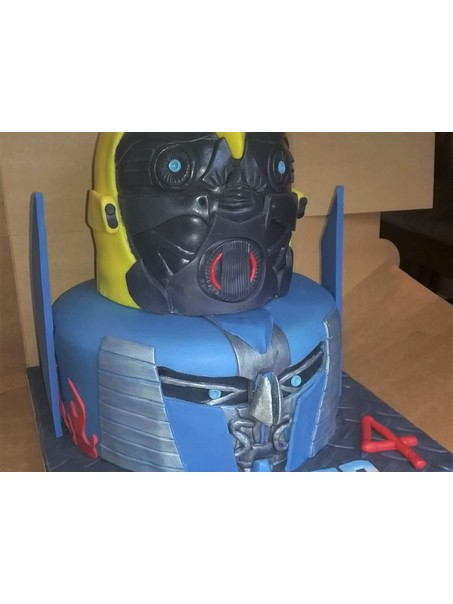 Optimus Prime open face shield and Bumblebee two-tiered cake.