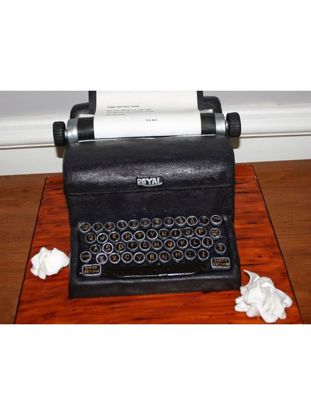 Royal typewriter cake. Chocolate WASC cake, hazelnut SMBC icing, fondant details, edible image for the typewritten page.