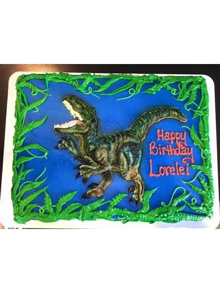 I iced this cake in dark blue buttercream, then piped the dinosaur on it in white buttercream, in layers and airbrushed the colors and highlights.