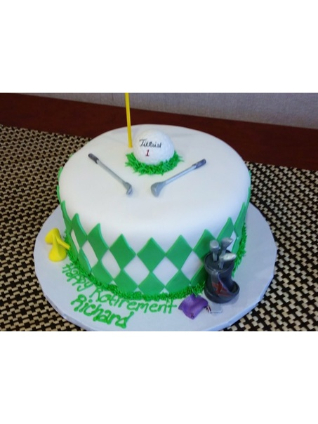 Fondant covered golf themed retirement cake with argyle, golf ball, golf clubs, tees