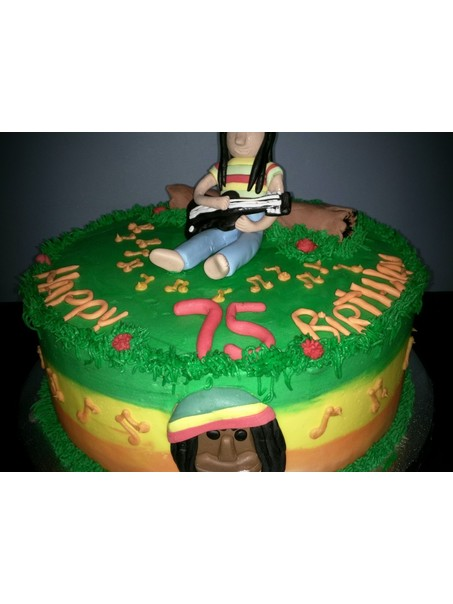 This cake was requested by a customer for a Reggae Themed birthday party. They were very specific with what they wanted on this cake as far as decoration goes.