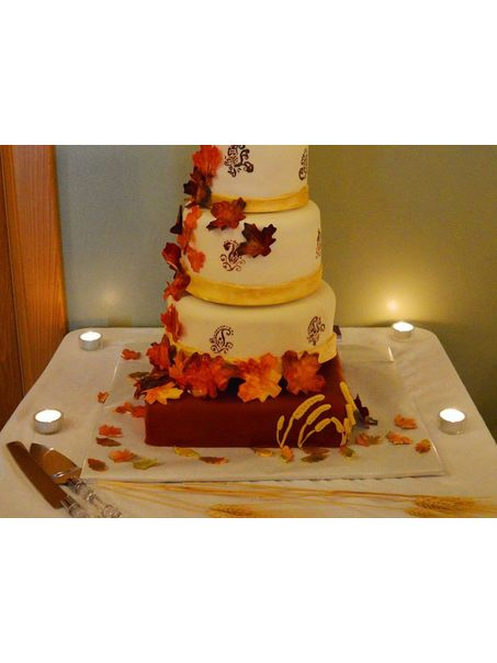A beautiful Fall wedding cake! All handmade fall leaves. Flavors are: Pumpkin,red velvet, apple cinnamon, and vanilla!