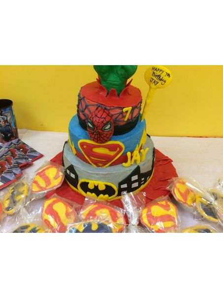 Combined batman , superman and the hulk. Accents are made of fondant but layers are iced in cream cheese frosting