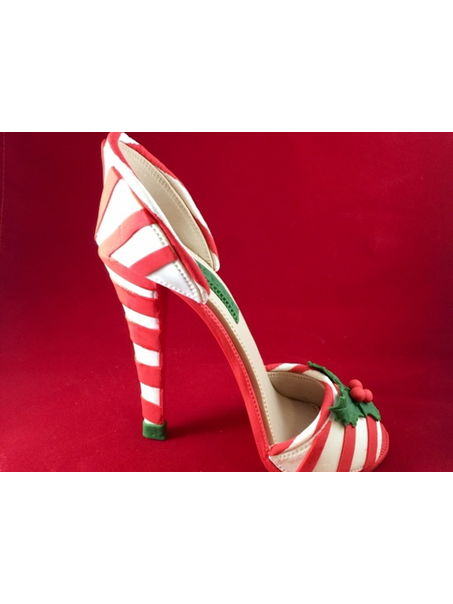This is my Christmas inspired gumpaste high heel shoe. Her name is Belle and she is the newest member to my Etsy Store! Happy Holidays!
