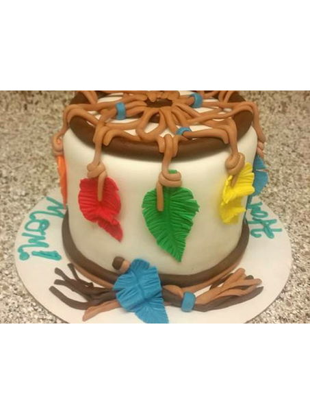 This was a cake i made for my moms birthday this year! She has always been into western and indian things, and loves dreamcatchers! Making feathers was a first for me, and i had to wing it, but i love the way they came out!