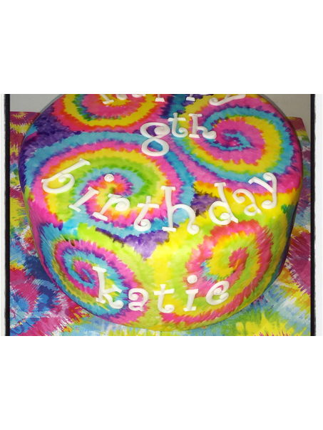 This was a fun cake to make. Covered with white mmf then handpainted the tie dye pattern on. Tie dyed the batter to match!