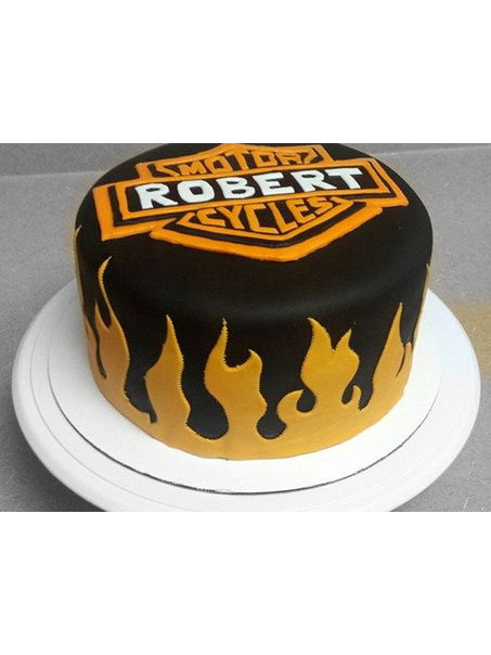 This cake was a last min. cake for my boss who in the entire 3 years i have known him, has never worn anything other than harley davidson attire