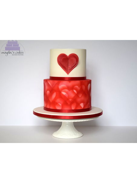 Valentines design. Bottom tier is airbrushed. Heart made of wafer paper.