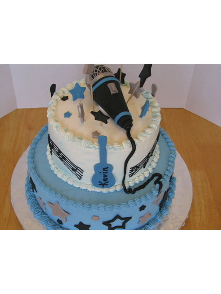 mic made of ice cream cone covered with fondant, ball end is rice krispies covered with fondant.
