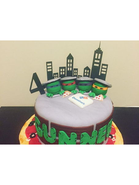 Everything handmade. Fondant with fondant accents. The city and 4 is made from cardstock.