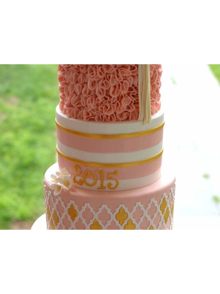 Pink and gold ruffled graduation cake.
