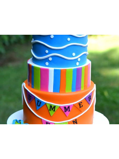 Colorful, pool party themed cake.