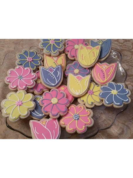 Tulips and Daisy cookies frosted with royal icing.